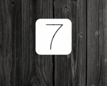 iOS 7 Logo with Dark Wood Background