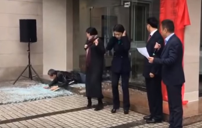 Man Shatters Glass Door During Chinese Ceremony In True Cartoonish Fashion