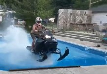 Guy Tries To Ride Snowmobile Across Pool