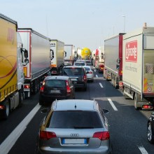 traffic jam with cars and trucks on busy highway