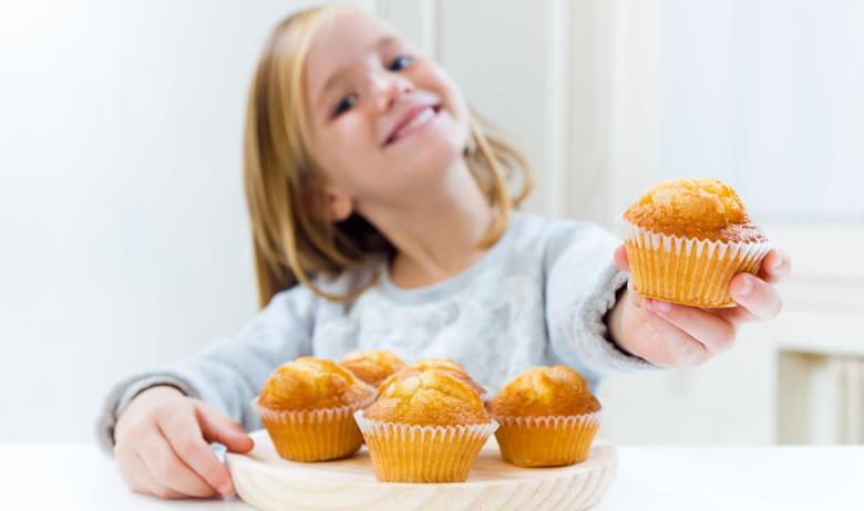 Little Girl Holding A Cake Stock Photo