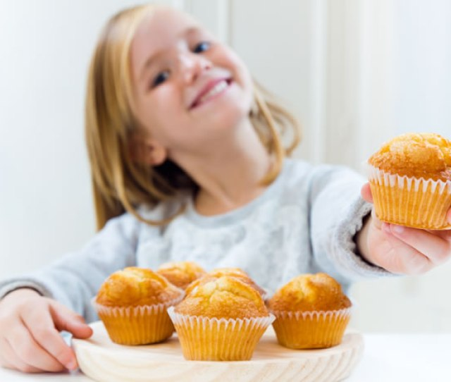 Little Girl Holding A Cake Stock Photo