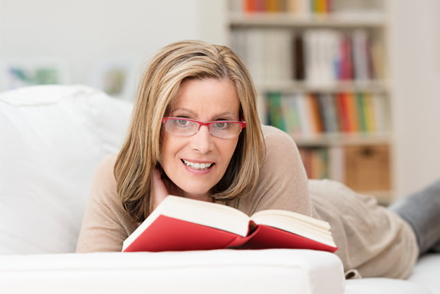 Woman Reading a Book - Refractive Lens - Freedom Eye Laser