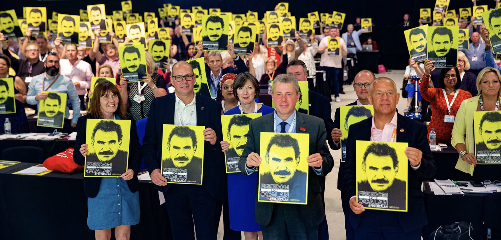 Steve Turner, assistant general secretary Unite the Union, Frances O'Grady general secretary TUC, Mark Serwotka general secretary PCS and president TUC, Tim Roache general secretary GMB holding placards calling for Abdullah Ocalans release Freedom for Ocalan at TUC congress 2019