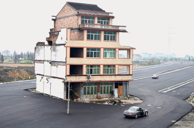 house in middle of street in china