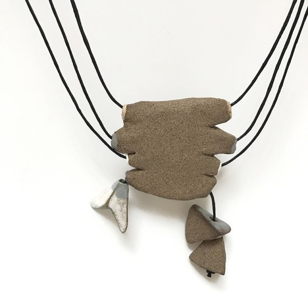 multiple Holes Pendant with Tail and Triangles by Roksana Pirouzmand