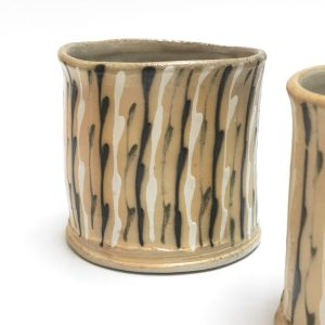 ceramic cups with black and white lines by Hayne Bayless