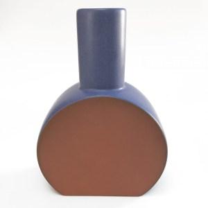 matte blue vase, round base, slender neck, unglazed face