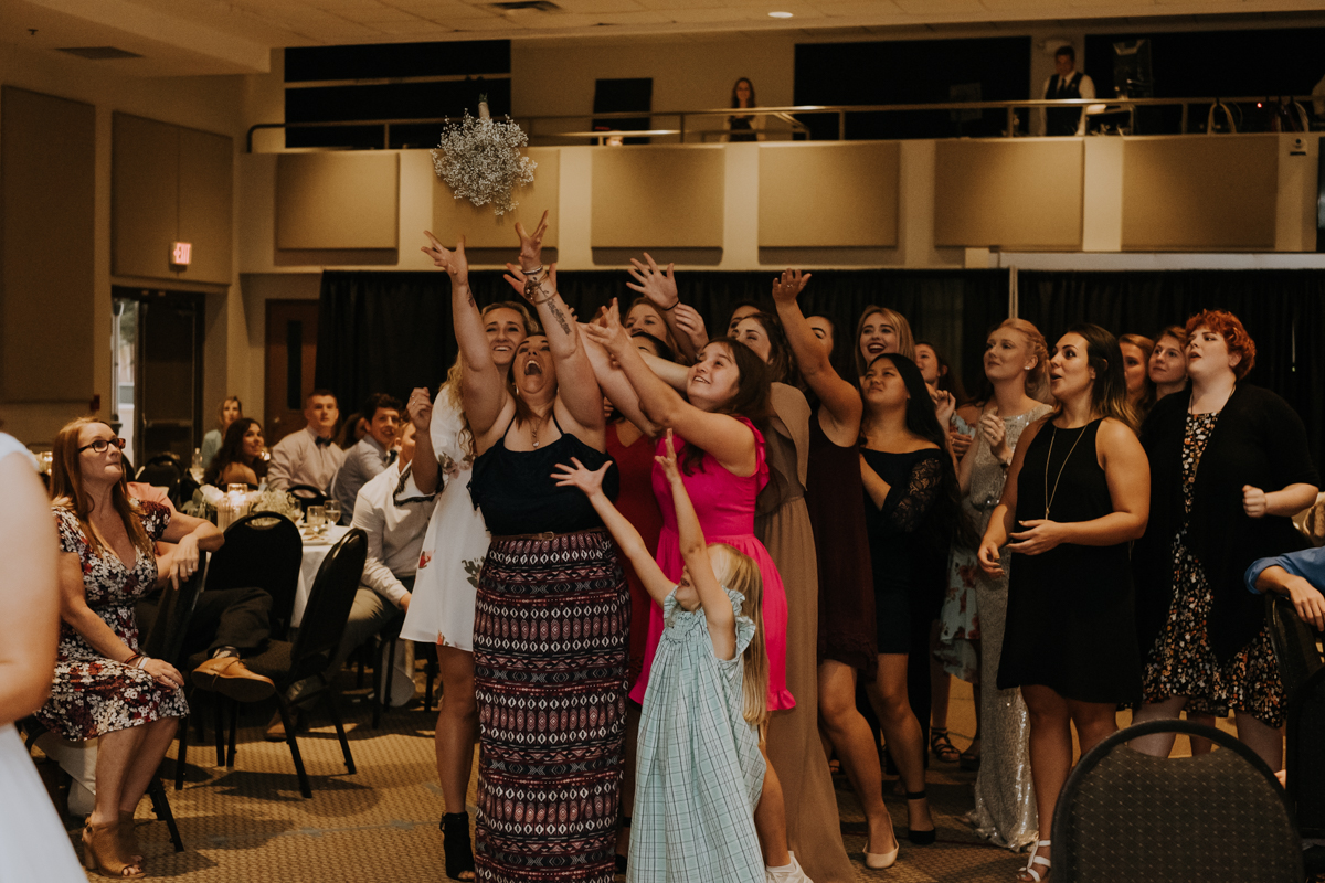 bouquet toss | Tampa wedding | Emily + Aaron | Freehearted Film Co | Tampa Wedding Photography and Wedding Videography