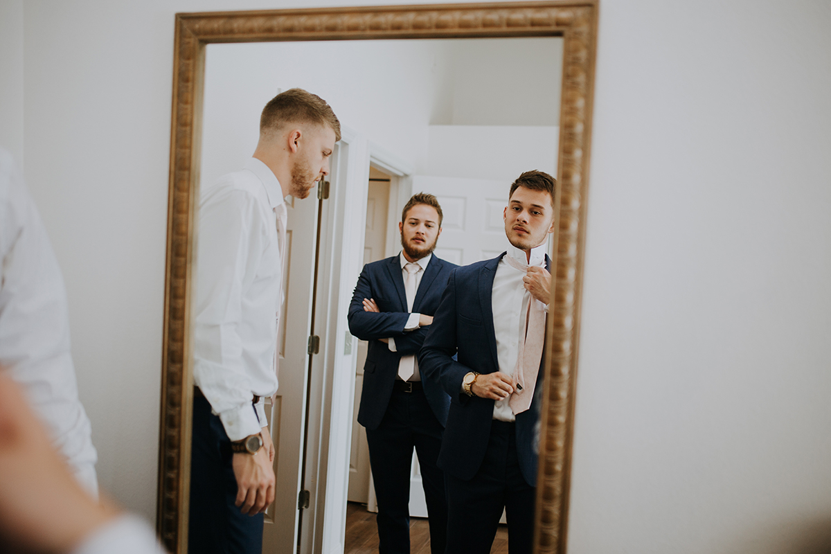 groom getting ready | straightening the tie | Florida wedding photographer
