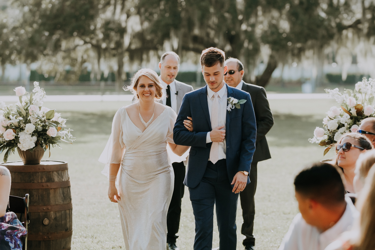groom and mother walking down the aisle | romantic sarasota wedding photographer | romantic sarasota wedding | tampa wedding photographer | freehearted film co