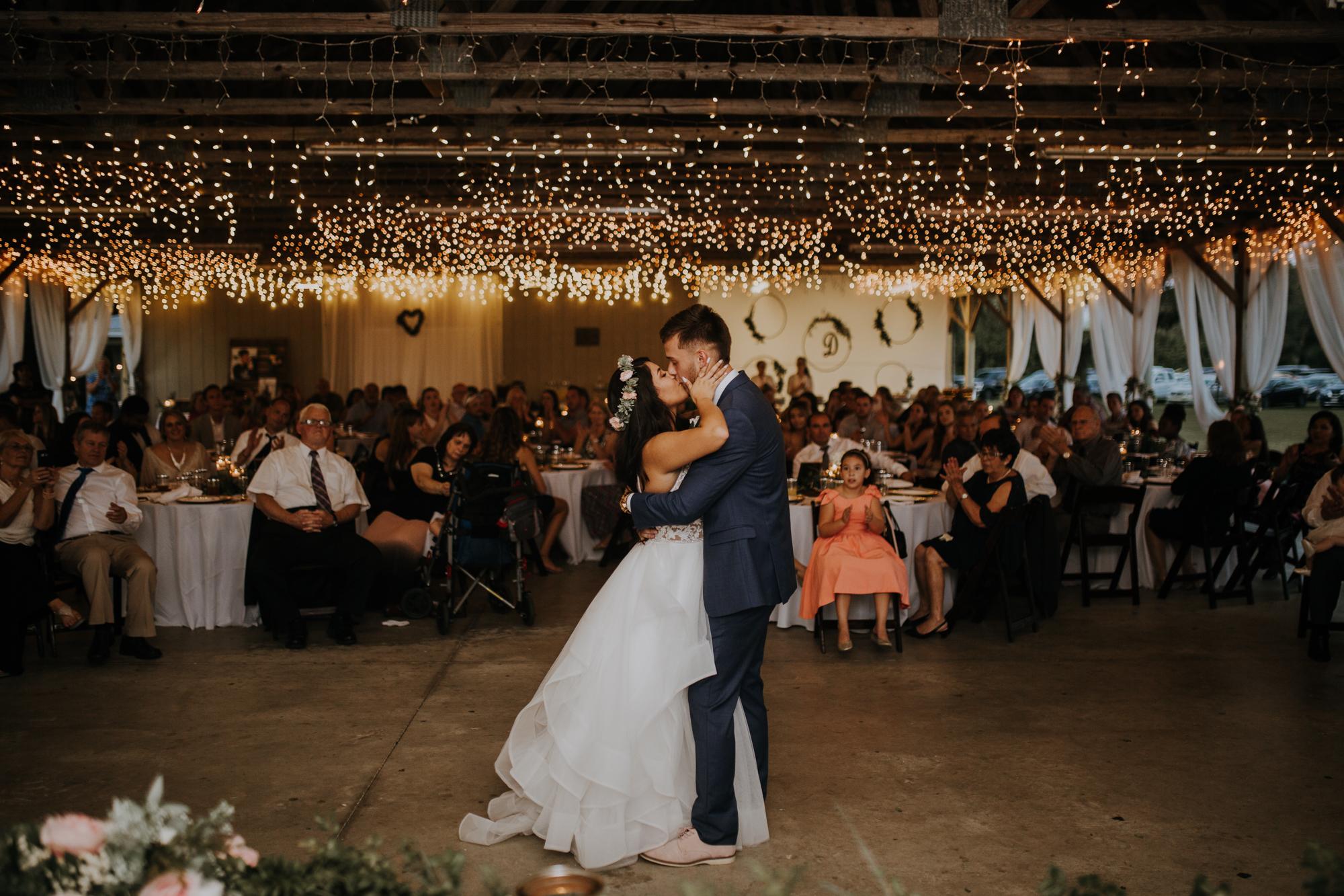 husband and wife first dance | wedding first dance | first dance as husband and wife | boho wedding reception | romantic sarasota wedding | twinkle lights at the reception | first dance under the twinkle lights