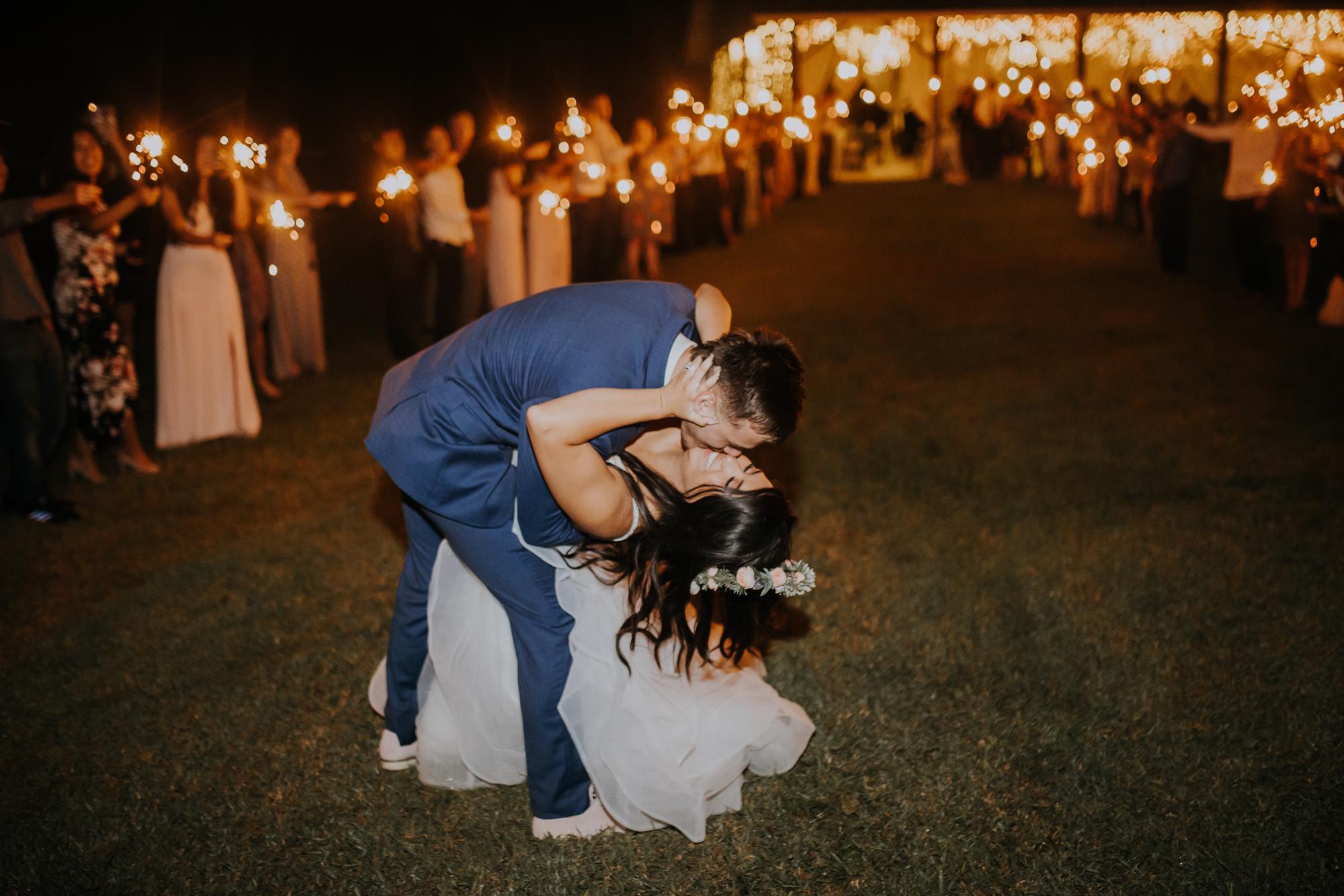 sparkler exit | wedding sparkler exit | romantic sparkler exit | outdoor Florida wedding | sarasota wedding | last kiss | dip and kiss