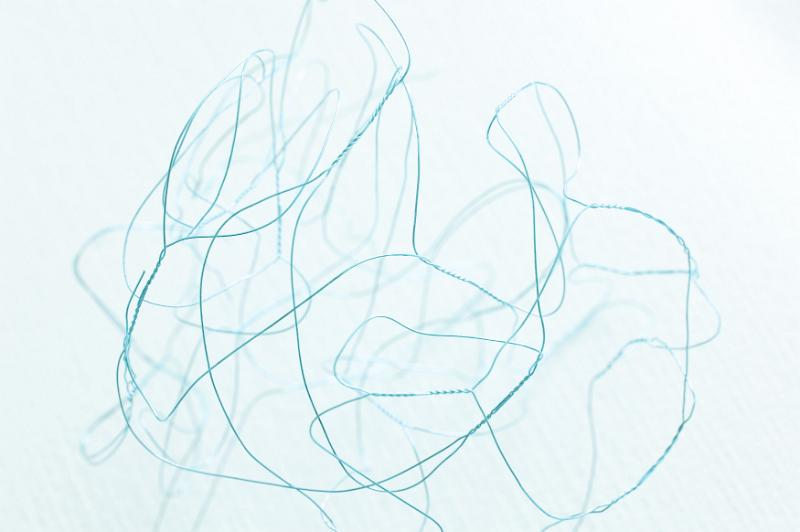 Free Stock Photo: Dainty abstract background made of one tangled blue wire appearing to float in liquid