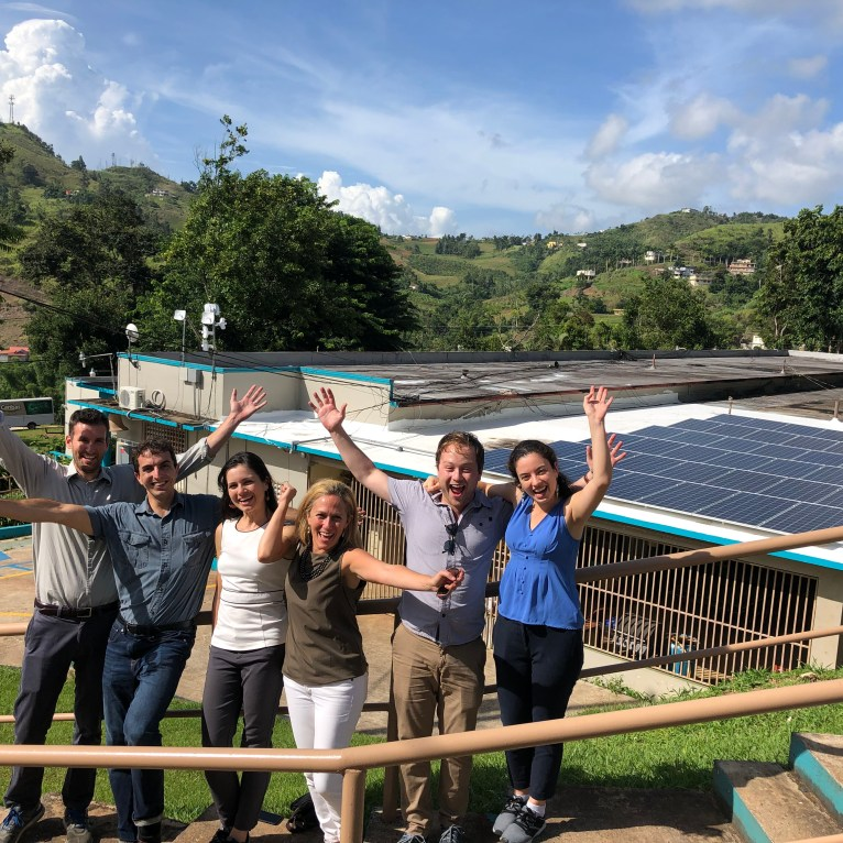 The RMI islands team in front of the Barranquitas solar microgrid