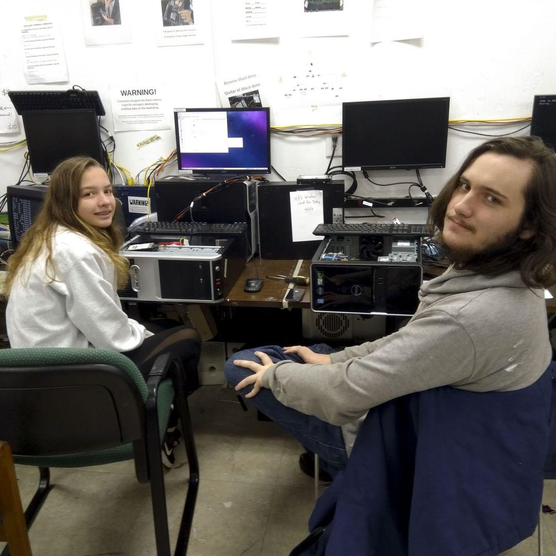 Two volunteers refurbish computers