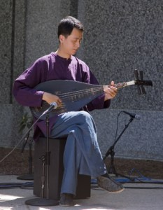 man playing an acoustic instrument
