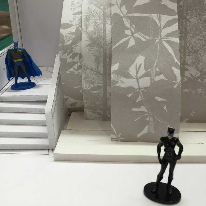 Batman and Catwoman figurines in Sōtatsu exhibition maquette