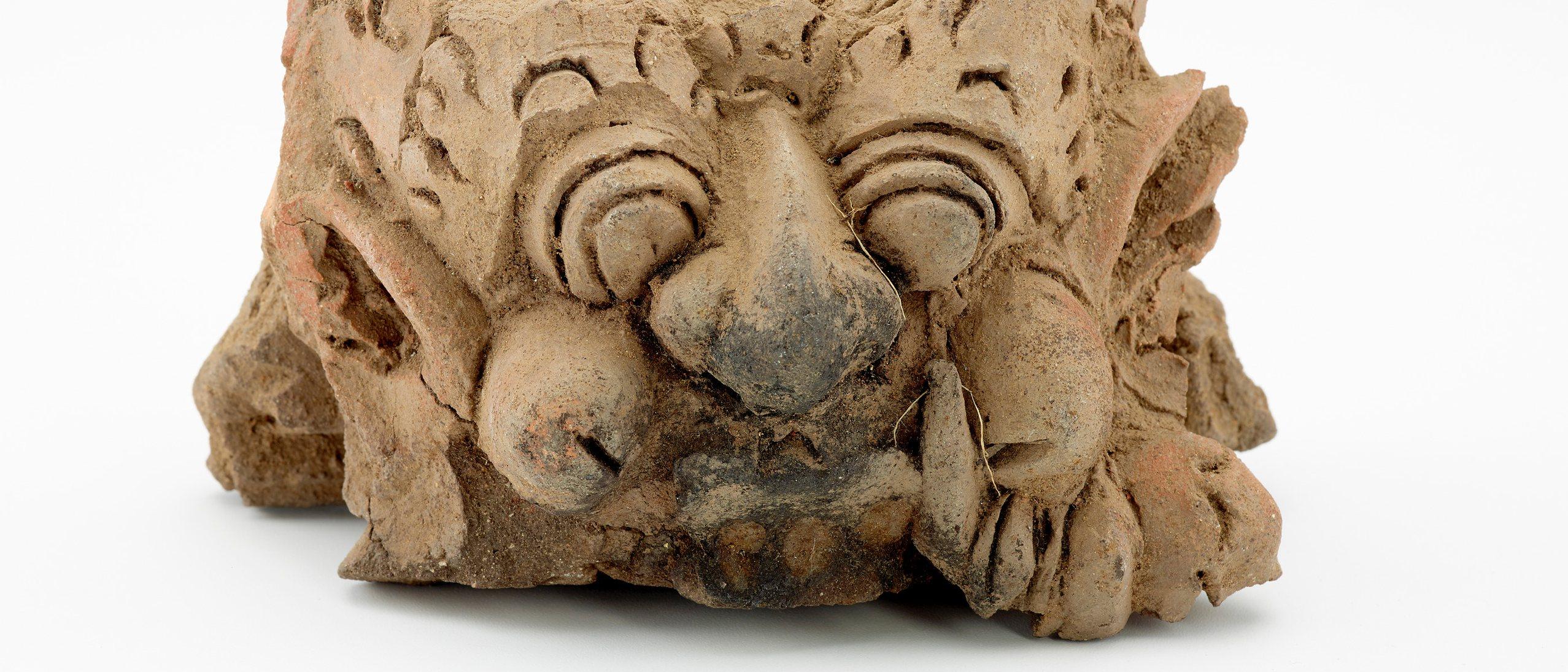 Terracotta (earthenware) kala head
