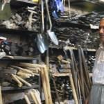 Kak Aziz looking at tools