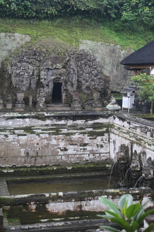 Cave façade and bathing place at Goa Gajah
