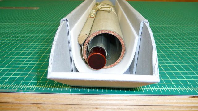 roll of paper on green gridded cutting mat