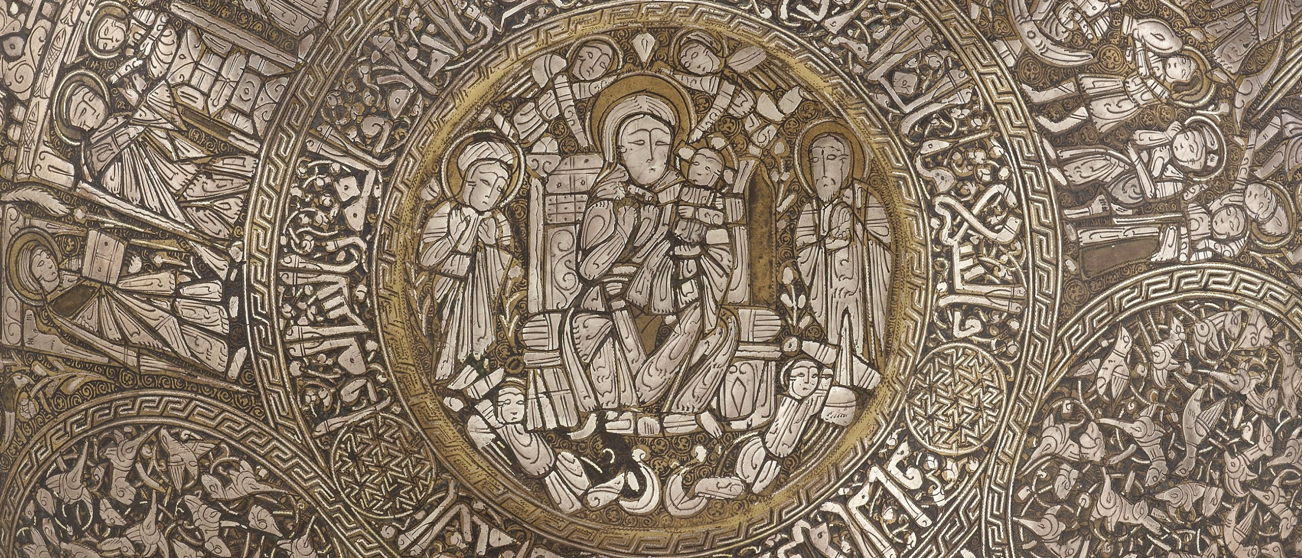 Chased silver detail of Christian imagery, inlaid with gold
