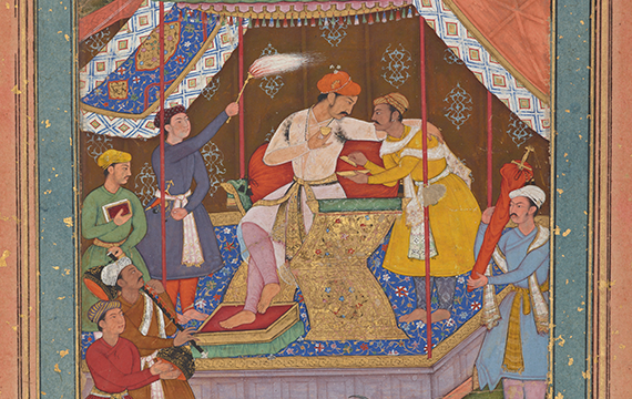 Traditional Indian painting where a man of power, underneath a colorful and patterned tent, is being waited on and entertained by servants, also in colorful garments.