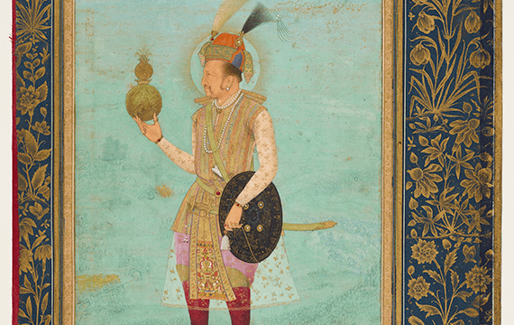 Traditional Indian painting of a man standing on a small platform on a grassy hill. He is dressed in vibrant garments, shoes and a hat. He is holding a shield and a circular object.