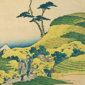 Detail of a woodblock print of a hilly landscape with two men standing in the foreground, and one man crouching, with the top of Mt. Fuji visible in the background.