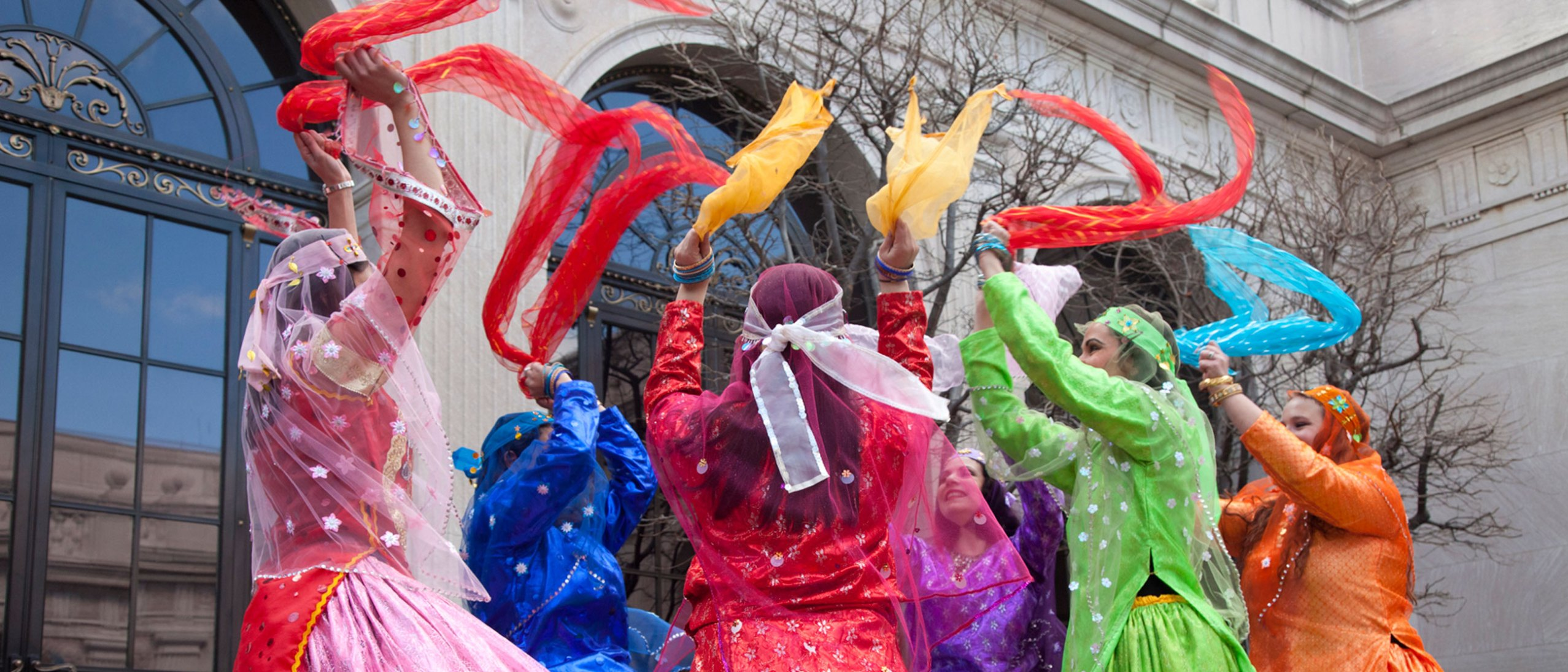 Dancers wave colored scarves at a Nowruz celebration
