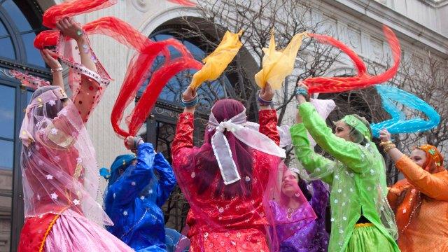 Dancers wave colored scarves at a Nowruz celebration