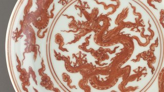 detail from a red and white plate, F1965.4