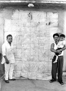 two men stand in front of the drawing