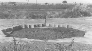 black and white image of a dried pool with scalloped edges