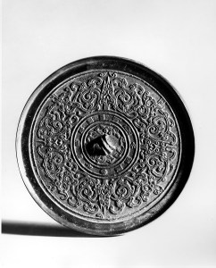 Photo, Bronze mirror. Western Han dynasty, 2nd century BCE., Diam: 18.2 cm. (7 1/8 in.) Singer catalogue number: [1011].