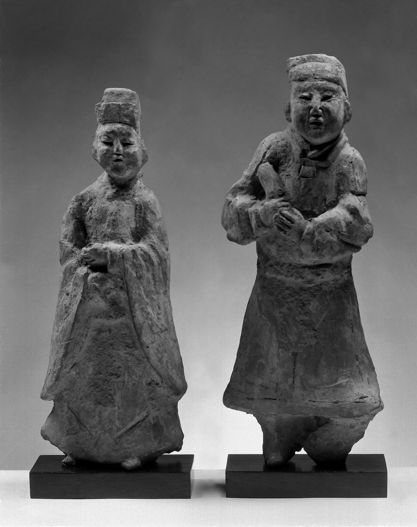 Photo, Pair of earthenware figures with traces of color. Six Dynasties period, 4th–5th century., H: 28.9 cm. (11 3/8 in.) and 31.4 cm. (12 3/8 in.) Singer catalogue number: [1127]. E