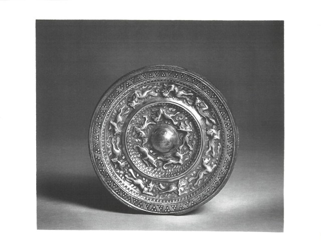 Photo, Bronze mirror with silver back. Sui–Tang dynasty, 7th century., Diam: 13 cm. (5 1/8 in.) Singer catalogue number: [1189].