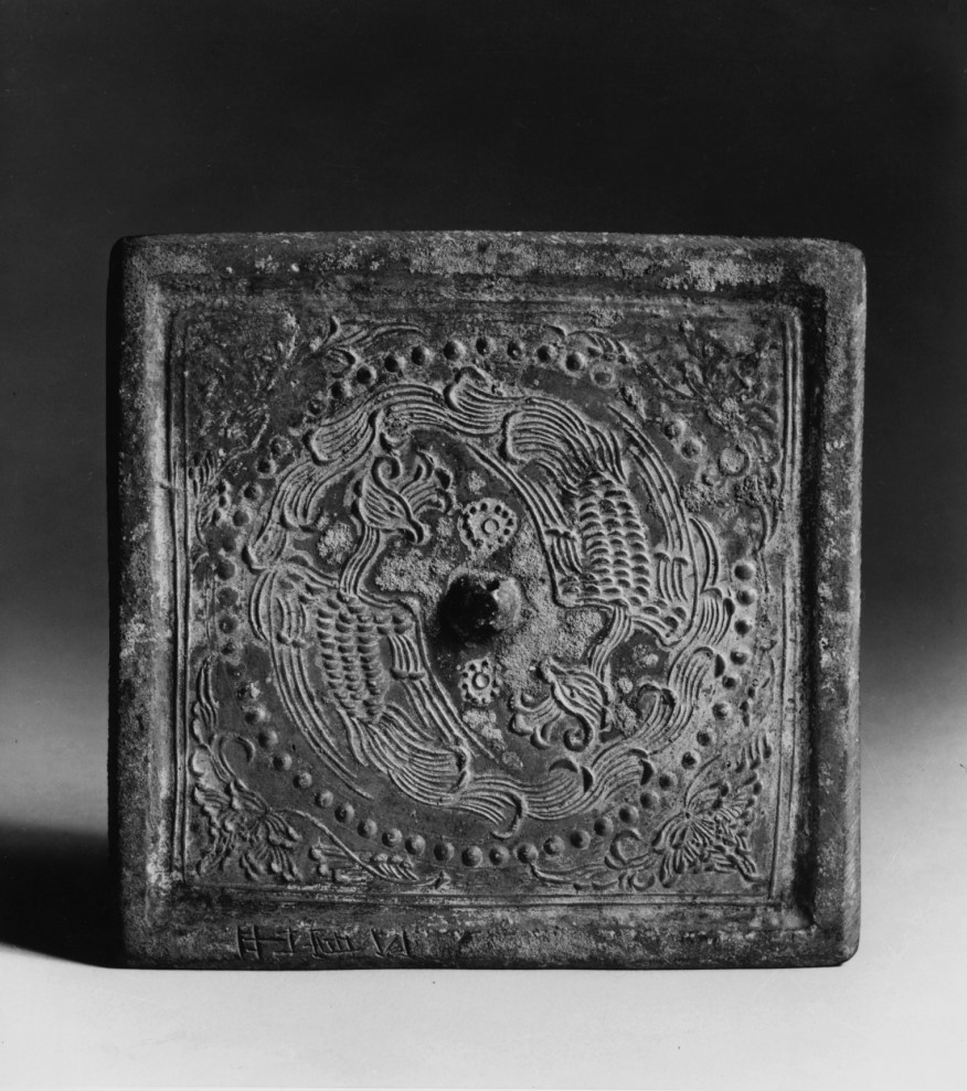 Photo of Bronze square mirror. Tang dynasty, 8th century., H: 11.6 cm. (4 9/16 in.). Singer catalogue number: [1397].