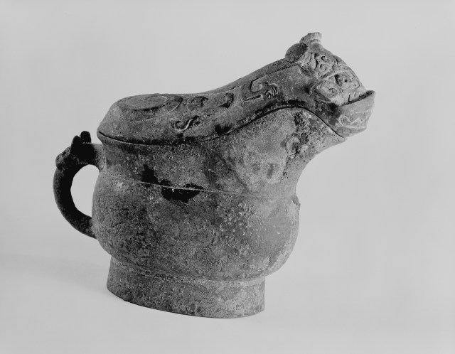 Photo, Bronze ritual wine vessel, type gong. Shang dynasty, 13th–11th century BCE., H: 17.5 cm. (6 7/8 in.). Singer catalogue number: [242].