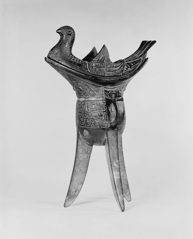 Photo, Covered bronze ritual wine container, type jiao. Western Zhou dynasty, 11th–10th century BCE., H: 27 cm. (10 5/8 in.) Singer catalogue number: [478].