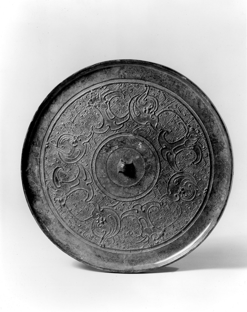 Photo, Bronze mirror. Eastern Zhou dynasty, 3rd century BCE., Diam: 19 cm. (7 1/2 in.) Singer catalogue number: [624].