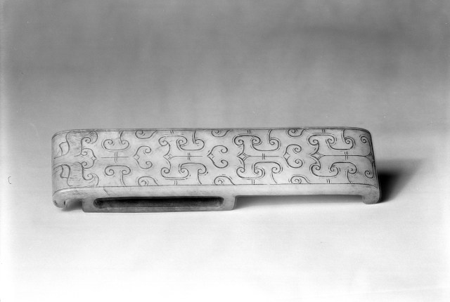 Photo, Jade scabbard slide. Western Han dynasty, 2nd century BCE., L: 12 cm. (4 3/4 in.). Singer catalogue number: [767].