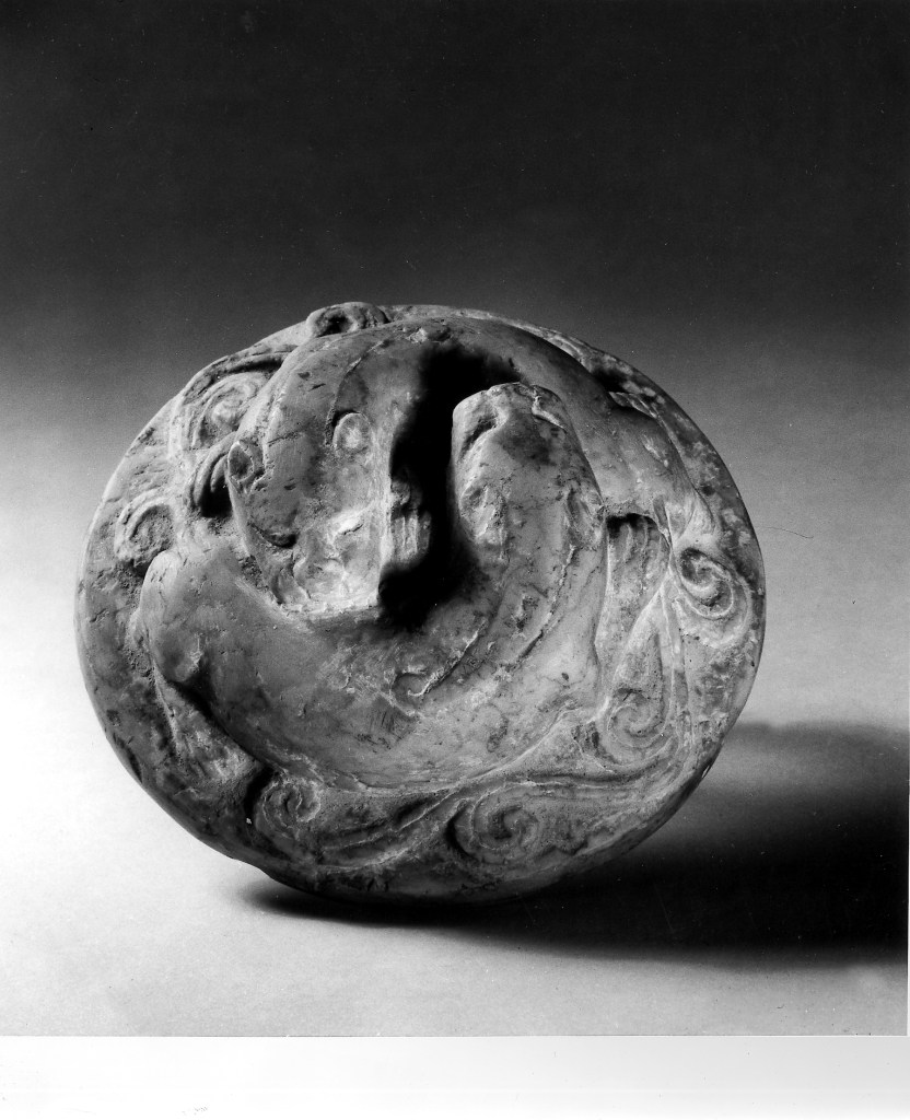 Photo, Steatite weight. Eastern Han dynasty, 24–220 CE., Diam: 7.7 cm. (3 in.). Singer catalogue number: [793].