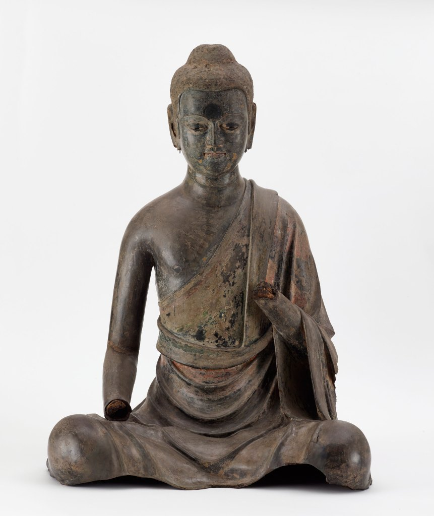 A seated buddha; the hands are missing