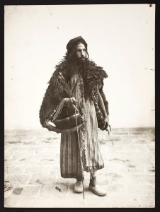 Photo, Dervish Carrying a Kashkul, or Beggar's Bowl, Sevruguin, Antoin,; b&w ; 16.6 cm. x 22.3 cm.; Myron Bement Smith Collection: Antoin Sevruguin Photographs. Freer Gallery of Art and Arthur M. Sackler Gallery Archives. Smithsonian Institution, Washington D.C. Gift of Katherine Dennis Smith, 1973-1985