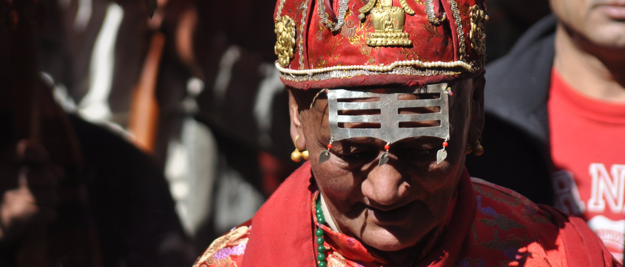 man in red ceremonial dress