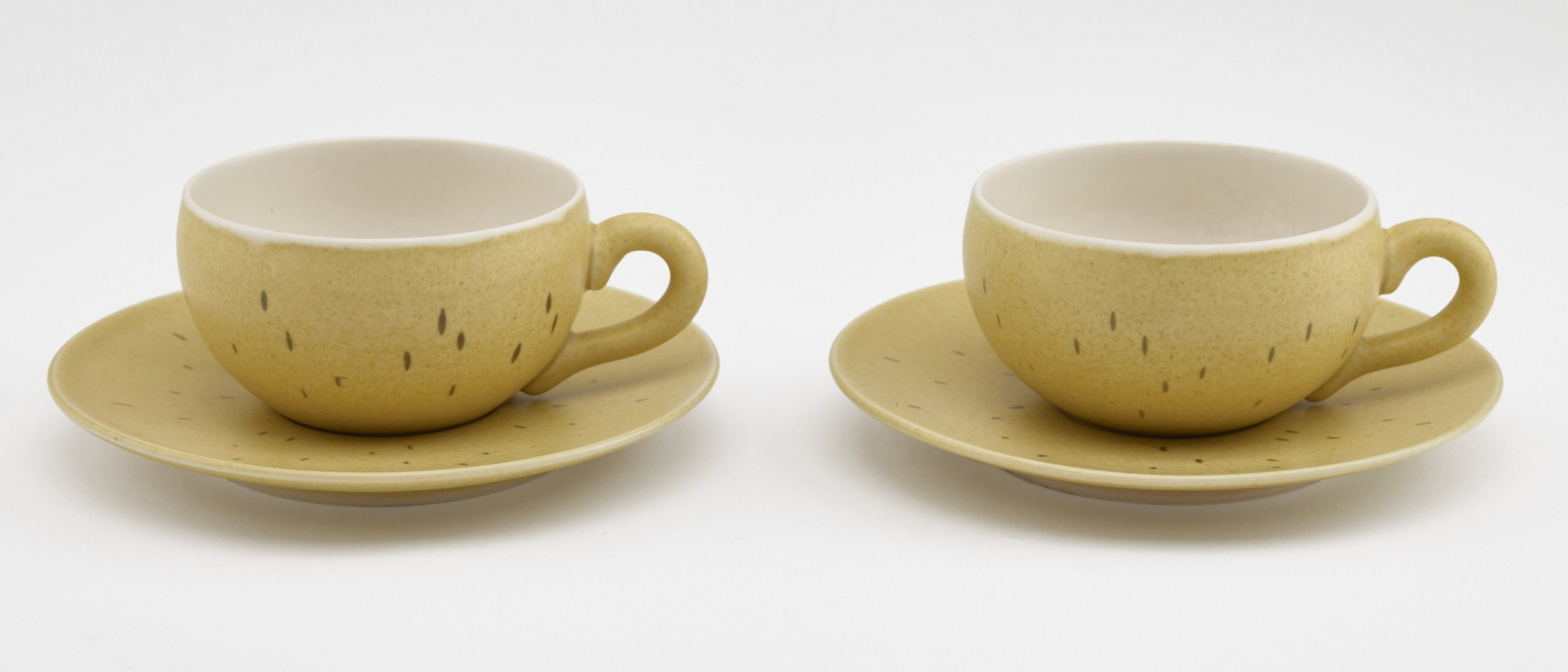 Photo of Pair of coffee cups and saucers; Yamada Hikaru (1924–2001); Japan, Kyoto, 1960s; Stoneware with yellow and clear glazes; Gift of Halsey and Alice North; Arthur M. Sackler Gallery S2017.15.1–2