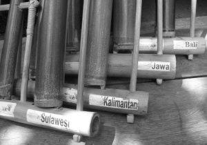 Angklung instruments labeled with Sulawesi, Kalimantan, Jawa, and Bali.