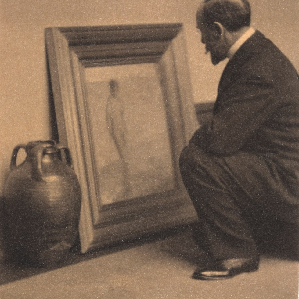 Freer comparing Whistler's Venus Rising from the Sea (F1903.174) to an Islamic glazed ceramic pot (F1905.61), 1909. Photograph by Alvin Langdon Coburn.